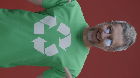 Man Pointing at Recycling Symbol on T-shirt