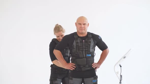 Thumbnail for Blonde Female Trainer Helps Man To Attach Electrode on Ems Suit