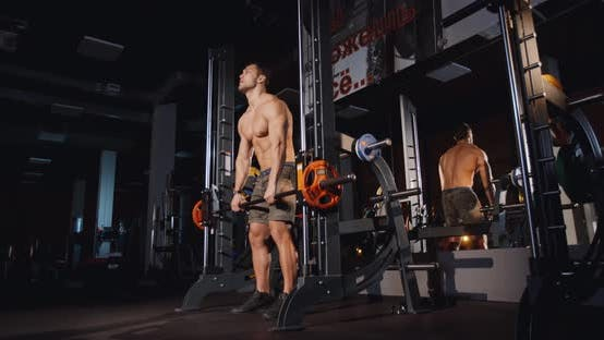 Cover Image for Athletic Man Workout with Heavy Barbell in Gym Muscle Training