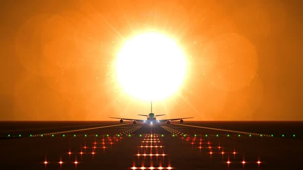 Cover Image for Big Airplane Departs From Airport Runway Against Large Sunset or Sunrise