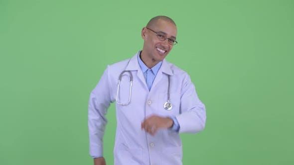 Thumbnail for Happy Bald Multi Ethnic Man Doctor Dancing