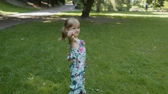 Thumbnail for Portrait of Little Girl Smiling. Child Having Fun in Park. Childhood. Jumping, Fighting, Dancing