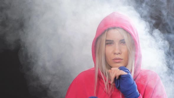Thumbnail for Female Boxer Prepares To Punch at Boxing Studio