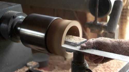 Carpenter Working with Woodworking Equipment