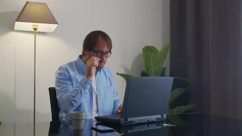 CloseUp. Shocked Man Wondering and Working on Laptop.