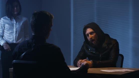 Thumbnail for Investigators Interrogating a Criminal