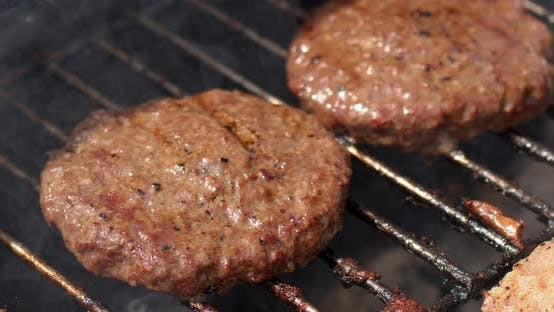 Thumbnail for Tasty Two Hamburger Meat Frying on Smoking Hot Barbecue