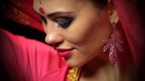 Thumbnail for Close-up of Attractive Indian Woman's Face with Oriental Makeup, and Bindi Point on Forehead at