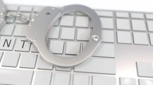 Handcuffs on Keyboard with TORRENT Text on Keys