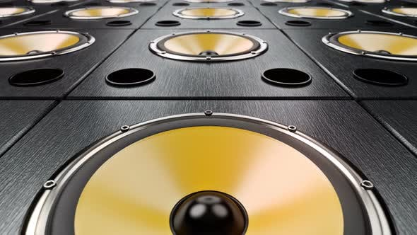 Moving Forward over Audio Speakers with Yellow Membranes Playing Modern Music