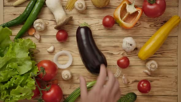 Thumbnail for Faceless Cook Taking Eggplant From Wooden Table. Vegetarian Food Concept