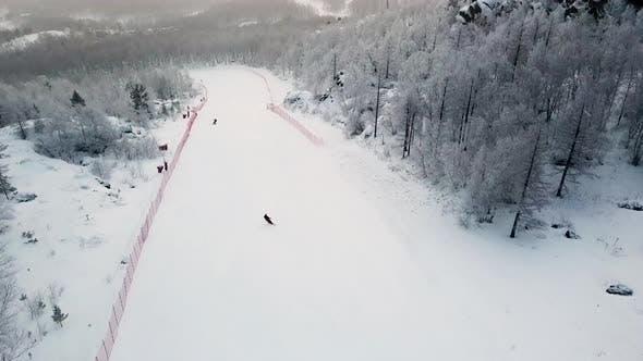 Thumbnail for White hill slope with ski tracks