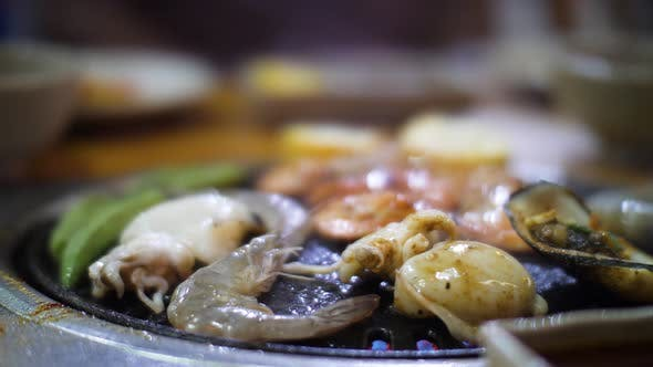 Close Up Shot of Vegetable Shrimps and Cuttlefishes Being Cooked and Grilled