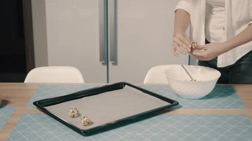 Woman Puts on Baking Tray Raw Cookies Before Baking