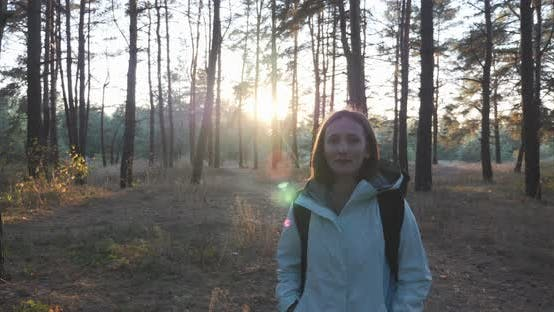 Thumbnail for Woman is walking in forest in sunlights