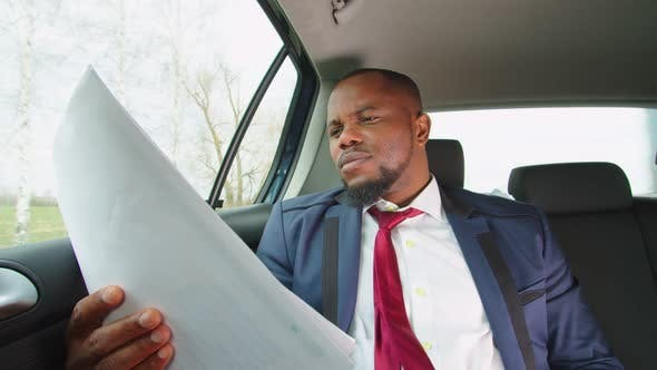 Black Businessman Taking Break From Work During Road Trip