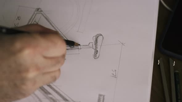 Thumbnail for Designer Drawing Bicycle Plans On Paper