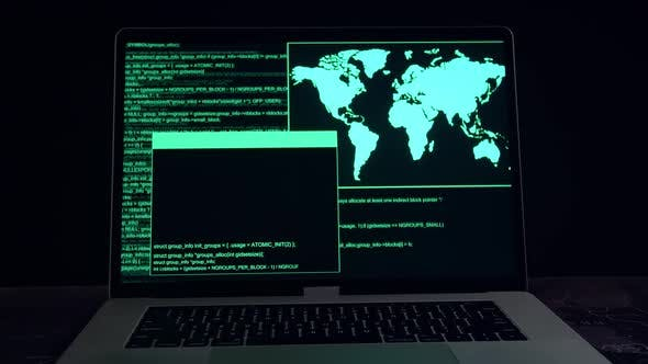 Hacker Concept. Code On A Laptop Computer Monitor In A Dark Room