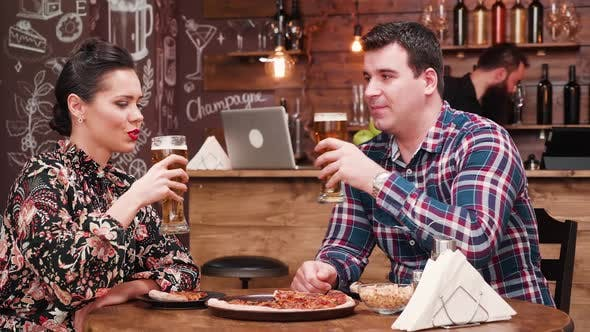 Thumbnail for Couple Discussing While Drinks Beer and Eats Pizza