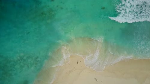 Luxury overhead travel shot of a paradise sunny white sand beach and aqua blue water background