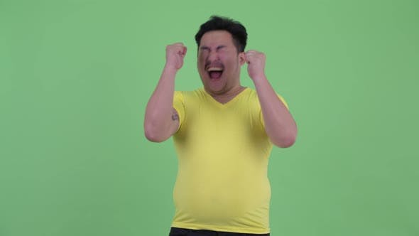 Thumbnail for Happy Young Overweight Asian Man Giving Thumbs Up and Looking Excited