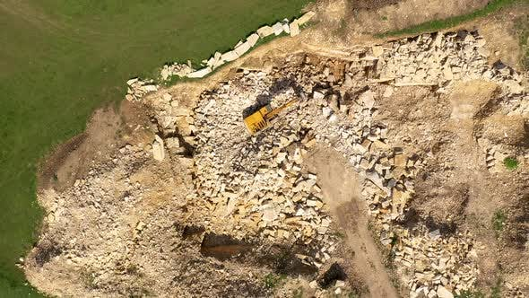 Thumbnail for Flying Above an Excavator Working in a Limestone Quarry