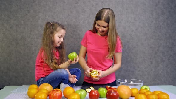 Thumbnail for Mother with daughter making salad. Daughter and mother together preparing healthy organic food