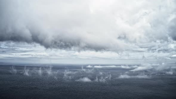 Thumbnail for Timelapse Aerial Video of the Deep Sea and Fog in the Sky