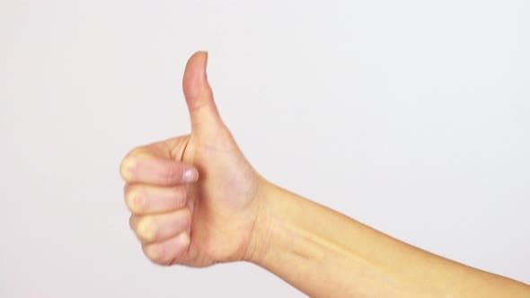 Thumbnail for A Woman Shows a Thumb Up To the Camera - Closeup on the Hand - White Screen Background