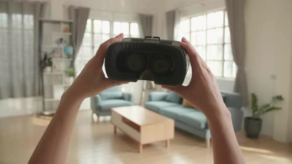 Putting On Virtual Reality Headset