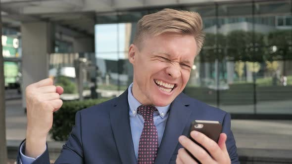 Thumbnail for Businessman Excited for Success while Using Smartphone