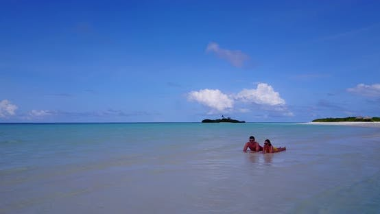 Thumbnail for Beautiful lady and man in love dating on vacation live the dream on beach on sunny white sandy