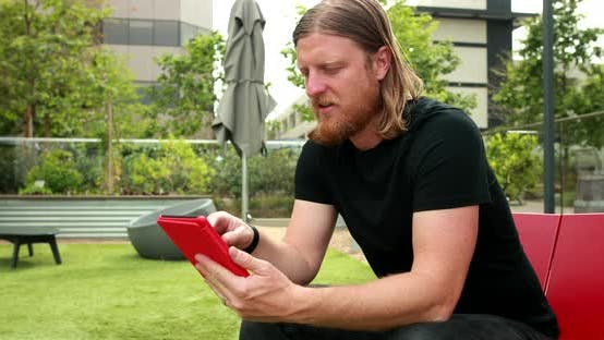 Man Reading An E Book