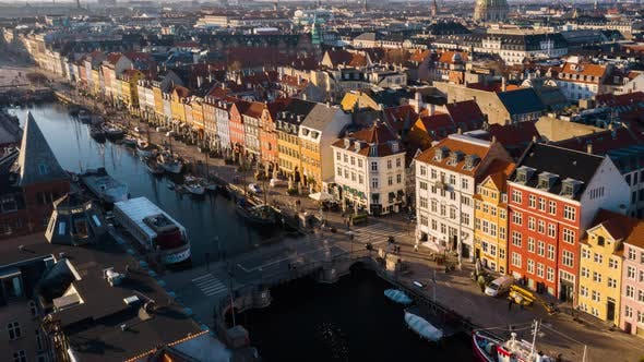 Thumbnail for Copenhagen with Cars Moving in Intersection and Buildings Surrounding the City