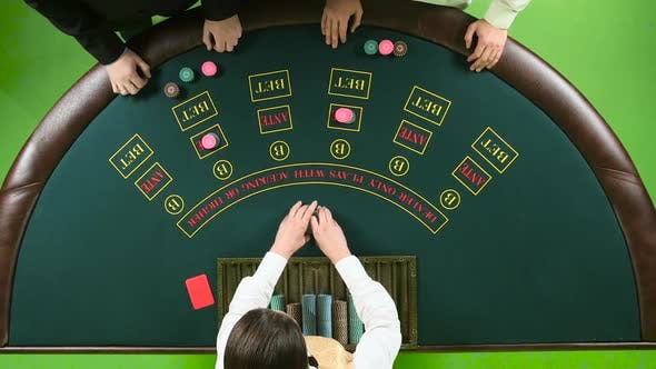 Thumbnail for Two Players Play the Poker in Casino Over the Green Table. Green Screen. Top View