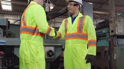 Factory Workers Handshake with Team Member in the Factory