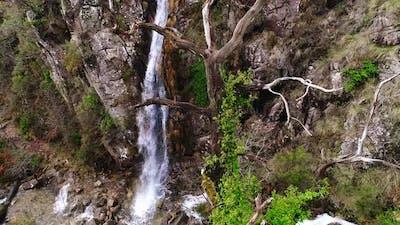 Waterfall Flowing Between Rocks