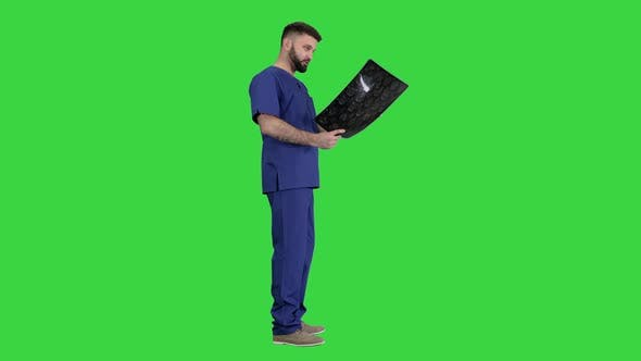 Shocked Doctor Looking at Brain Mri Result on a Green Screen, Chroma Key