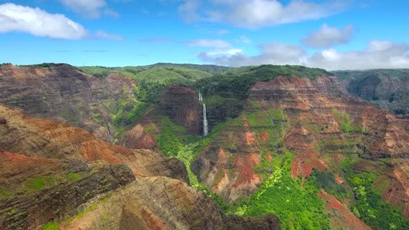 Aerial view of jurssic falls at Waimea Canyon In Kauai Island