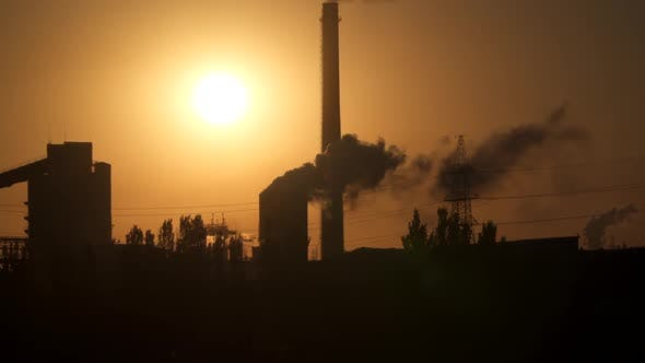 Thumbnail for Smoke from pipe pollutes environment in dawn