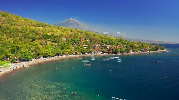 Thumbnail for Low Angle Drone Moving Over the Boats on the Sea at Jemeluk Bay at Background Agung Volcano, Amed