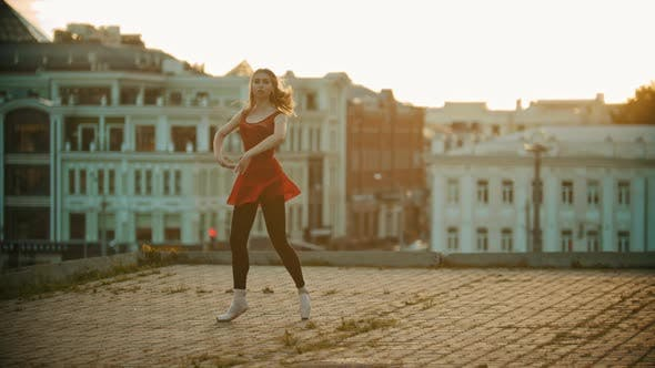 Thumbnail for Young Smiling Woman Ballerina Training on the Roof