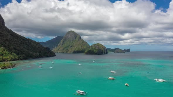 Cover Image for Beautiful Clouds and Azure Sea in the El Nido Bay and Cadlao Island, Palawan, Philippines