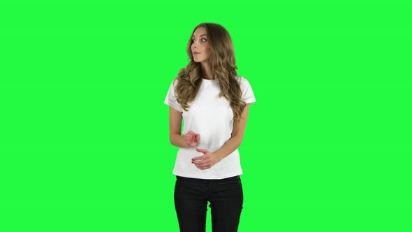 Cover Image for Lovable Girl Looking with Excitement, Then Celebrating Her Victory Triumph. Green Screen