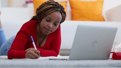 Woman Online Studying Writing Homework in Notebook Looking at Laptop Spbi