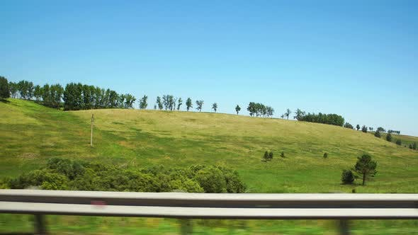 Thumbnail for Moving along a green hills and green trees