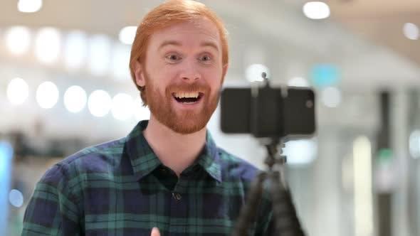 Redhead Blogger Making Video on Smartphone, Blogging