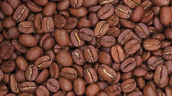 Spinning roasted Arabica coffee beans background