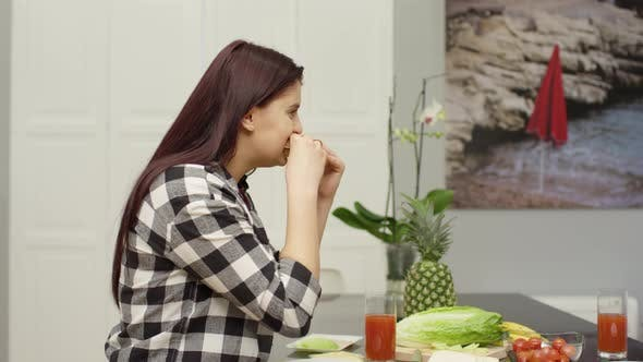 Girl eating a sandwich