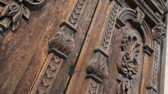 Thumbnail for Slide Shot of an Old Wooden Door of a Beautiful Ancient Building. Wood Texture Doors. Close Up